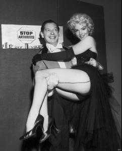 Marilyn_Monroe_at_the_circus_benefiting_the_Arthritis_and_Rheumatism_Foundation_in_Madison_Square_Garden_12_with_Uncle_Miltie.jpg