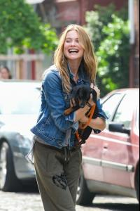 Behati+Prinsloo+Behati+Prinsloo+Cuddles+Puppy+9oFS4JnmO09x.jpg