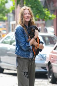 Behati+Prinsloo+Behati+Prinsloo+Cuddles+Puppy+zVEg2sJjRu5x.jpg