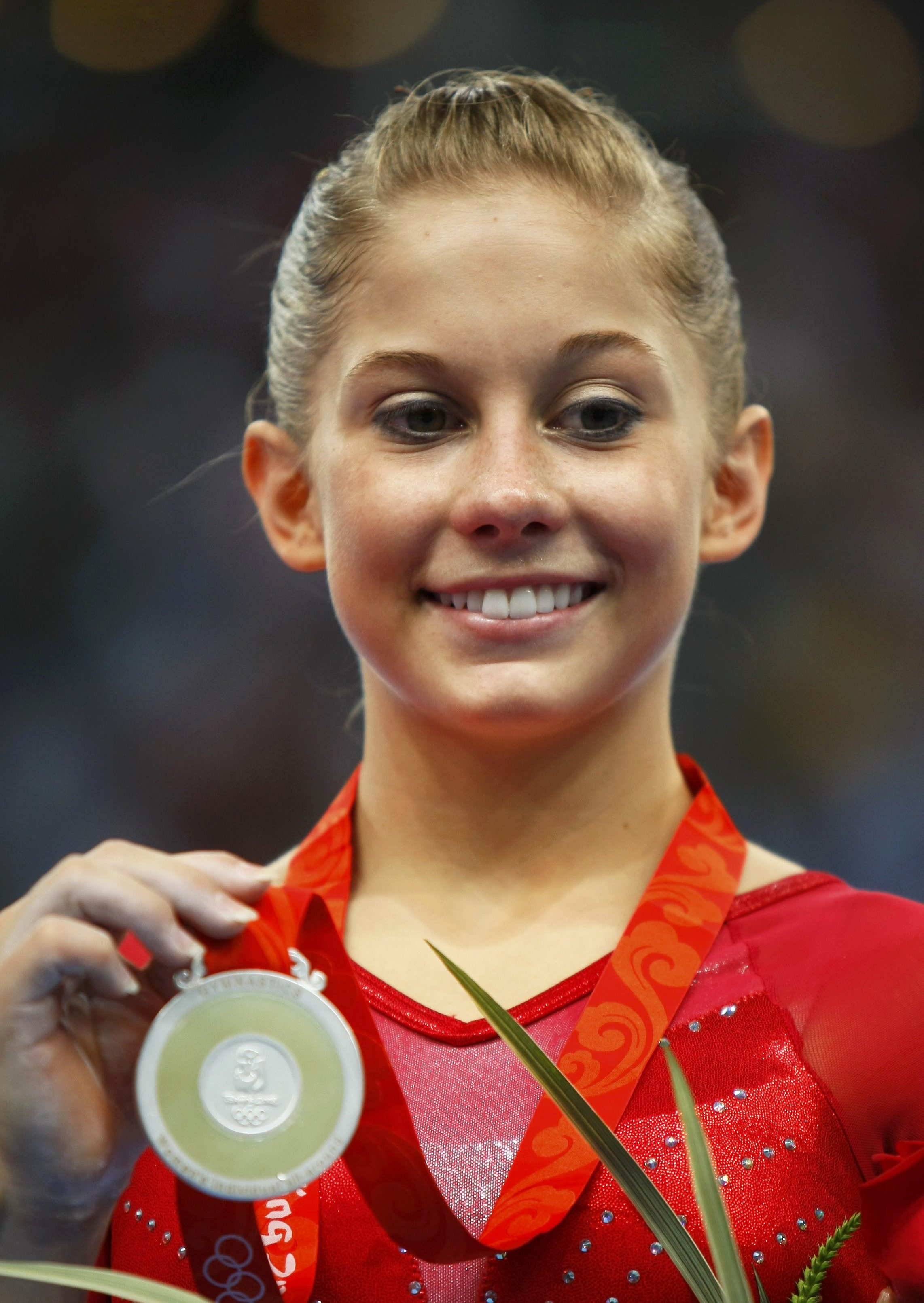 The 26-year old daughter of father Doug Johnson and mother Teri Johnson, 145 cm tall Shawn Johnson in 2018 photo