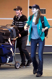 Alexandra Daddario & Leven Rambin - at the Vancouver airport - 080412_103.jpg