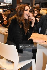 nabilla-benattia-poses-for-a-selfie-with-fans-during-trop-vite-book-picture-id657838222.jpg