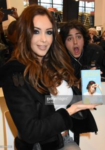 nabilla-benattia-poses-with-her-book-from-jai-lu-editions-during-trop-picture-id657838132.jpg