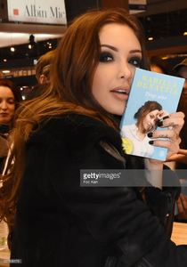 nabilla-benattia-poses-with-her-book-from-jai-lu-editions-during-trop-picture-id657838178.jpg
