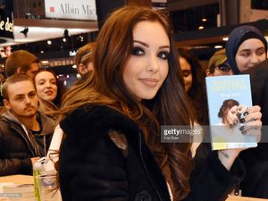 nabilla-benattia-poses-with-her-book-from-jai-lu-editions-during-trop-picture-id657838186.jpg