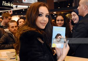 nabilla-benattia-poses-with-her-book-from-jai-lu-editions-during-trop-picture-id657838188.jpg