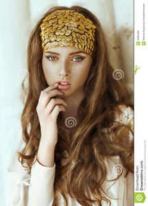 young-beautiful-girl-long-hair-gold-fashion-crown-portrait-model-blue-eyes-make-up-35965389.jpg
