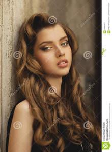 young-beautiful-girl-long-hair-gold-make-up-black-dress-portrait-fashion-model-blue-eyes-curly-brown-35965471.jpg