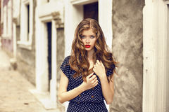 young-beautiful-girl-standing-street-model-red-lips-red-flowers-curly-hear-sunny-day-35965054.jpg