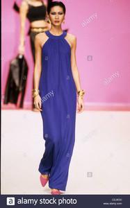yves-saint-laurent-spring-summer-model-wearing-long-dark-blue-halterneck-CEJKD0.jpg