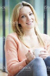 31568278-teenage-girl-relaxing-at-home-with-hot-drink.jpg
