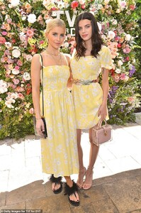 12741334-6961479-Twinning_Caroline_and_Sonia_wore_matching_floral_dresses_from_th-a-56_1556267116011.jpg