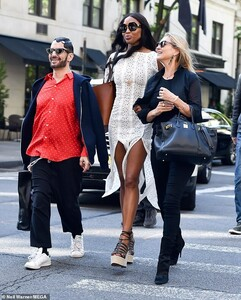 13215710-7003089-Iconic_She_boosted_her_never_ending_legs_with_a_pair_of_elegant_-m-93_1557262342604.jpg