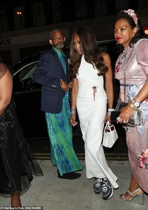 18505616-7466329-Making_a_statement_Naomi_Campbell_wore_a_white_gown_embellished_-m-29_1568568227260.jpg
