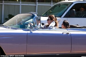 26142932-8128689-Could_it_be_Jenner_later_picked_up_a_second_passenger_a_dark_hai-a-20_1584581138766.jpg