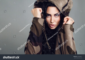 stock-photo-beautiful-young-model-girl-asian-appearance-with-elegant-luxuriant-hair-black-hooded-camouflage-454069651.jpg