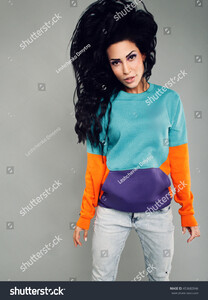 stock-photo-young-girl-of-asian-appearance-model-with-black-long-hair-jumping-in-sports-bright-clothes-on-a-453682846.jpg