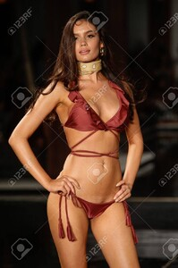 84695693-miami-fl-july-21-a-model-walks-the-runway-at-the-7th-annual-style-saves-swim-fashion-show-in-setai-h.thumb.jpg.9b03909b74e9cafafe7b5e94aab28cdf.jpg