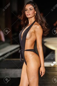 84695741-miami-fl-july-21-a-model-walks-the-runway-at-the-7th-annual-style-saves-swim-fashion-show-in-setai-h.thumb.jpg.88c6d3dd47a07e27ae6818b6b14f1bab.jpg