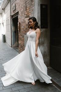 suri-wedding-dress-plain-skirt-movement-beading-top.jpg