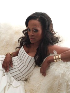 Robin Givens - lowcut white dress.jpg