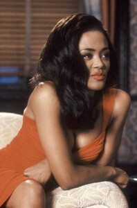 Robin Givens - lowcut orange dress.jpg