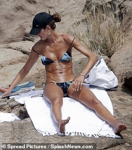 38010184-9148003-Getting_the_sun_She_sunbathed_on_her_front_to_ensure_she_had_an_-a-227_1610643779718.jpg