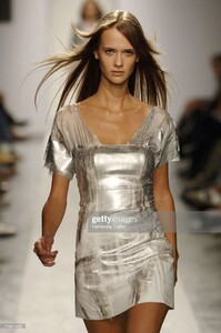 model-walks-down-the-runway-during-the-zoomp-summer-2007-fashion-show-picture-id71431405.thumb.jpg.870a52cf239360502d68390cceee5deb.jpg