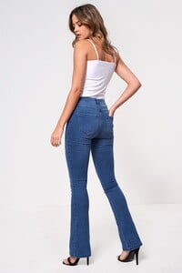 high_rise_flared_jeans_in_mid_wash_blue-2_1.jpg