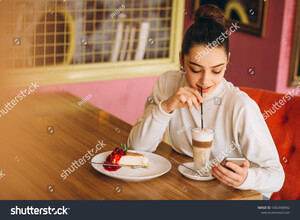 stock-photo-girl-with-phone-drinking-coffee-in-a-cafe-1082908982.jpg
