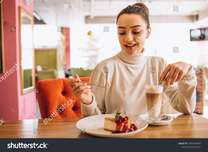stock-photo-woman-drinking-coffee-with-dessert-in-a-cafe-1082909084.jpg