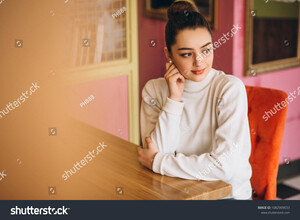 stock-photo-woman-sitting-in-a-cafe-1082909033.jpg