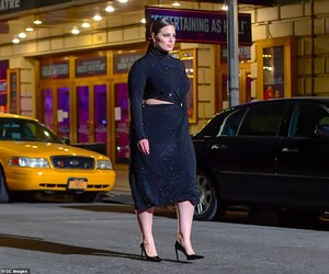41527414-9452311-Mix_and_match_Ashley_Graham_s_dress_seemed_to_find_a_middle_grou-a-316_1617947558833.jpg