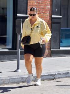 ashley-graham-in-bike-shorts-and-yellow-windbreaker-santa-monica-05-05-2021-2.jpg