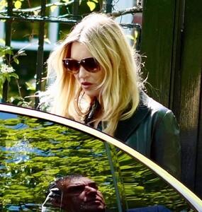 kate-moss-in-a-long-black-coat-and-dark-sunglasses-london-05-19-2021-0.jpg