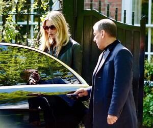 kate-moss-in-a-long-black-coat-and-dark-sunglasses-london-05-19-2021-4.jpg